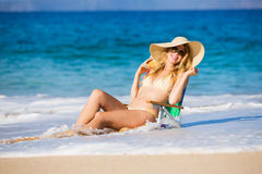 Beautiful Woman Relaxing on the Beach Royalty Free Stock Photography