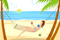 Beautiful woman relaxing on beach in hammock Royalty Free Stock Photo
