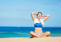 Beautiful woman relaxing on the beach in Hawaii Stock Photo
