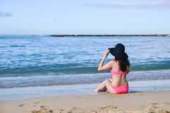 Beautiful woman relaxing on beach in Hawaii Stock Photos