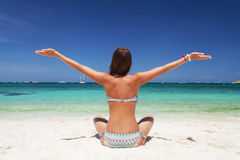 Beautiful woman relaxing on the  beach Stock Images