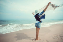 Beautiful woman relaxing on the beach. Person having fun with cloth and blue sky background. Summer vacation and leisure concept Royalty Free Stock Photo