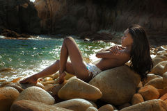 Beautiful woman relaxing on the beach. Stock Photography