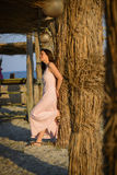 Beautiful woman relaxing on the beach on sunset Royalty Free Stock Photo