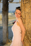 Beautiful woman relaxing on the beach on sunset Stock Photography
