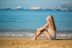 Beautiful woman relaxing on the beach. Beautiful young woman relaxing on the beach Royalty Free Stock Photos