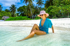 Beautiful woman relaxing on a beach Royalty Free Stock Photo