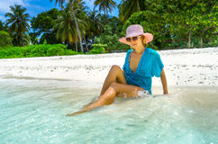 Beautiful woman relaxing on a beach Royalty Free Stock Images