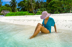 Beautiful woman relaxing on a beach Stock Images