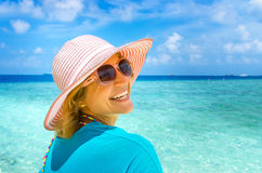 Beautiful woman relaxing on a beach Stock Photography