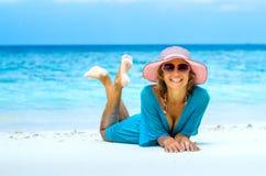 Beautiful woman relaxing on a beach Stock Photo