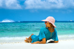 Beautiful woman relaxing on a beach Royalty Free Stock Image