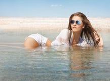 Beautiful woman relaxing on beach Stock Image