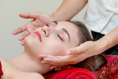 Woman relaxing in the beauty treatment,Facial massage Stock Image