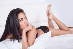 Beautiful woman relaxing in bed Stock Image