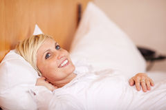 Beautiful Woman Relaxing On A Bed Royalty Free Stock Photo