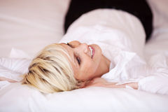 Beautiful Woman Relaxing In Bed Royalty Free Stock Image