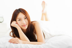Beautiful woman relaxing on the bed Stock Images