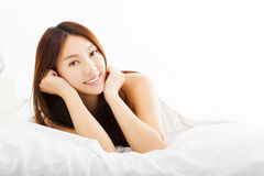 Beautiful woman relaxing on the bed Stock Photography