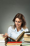 Beautiful woman relaxing with books Royalty Free Stock Images