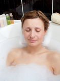 Beautiful woman relaxing in a bubble bath Royalty Free Stock Images