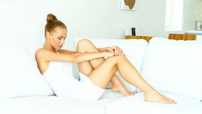 Beautiful woman relaxing on couch