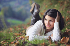 Beautiful woman relaxing in countryside Stock Photo