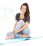 Beautiful woman relaxing after doing exercise Royalty Free Stock Photography