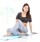 Beautiful woman relaxing after doing exercise Stock Photography