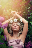 Beautiful Woman Relaxing in Flowers Outdoors Stock Photo