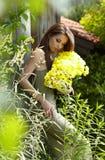 .Beautiful woman relaxing in garden. Royalty Free Stock Image