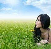 Beautiful woman relaxing in the grass Royalty Free Stock Image