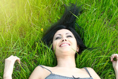Beautiful woman relaxing in the grass Royalty Free Stock Photography