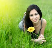 Beautiful woman relaxing in the grass Royalty Free Stock Photos
