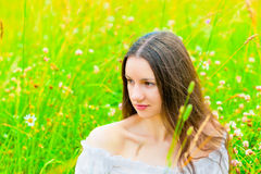 Beautiful woman relaxing in green grass Royalty Free Stock Images