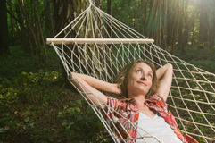 Beautiful woman relaxing in hammock Stock Photography