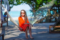 Beautiful woman relaxing on hammock during summer Stock Photos