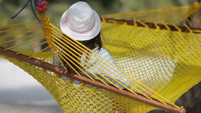 Beautiful woman relaxing at hammock on tropical beach. Beautiful woman relaxing at hammock on beach stock video