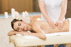 Massage. Beautiful woman relaxing and having massage in spa salon stock photography