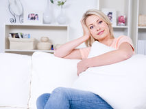 Beautiful woman relaxing at home Stock Images