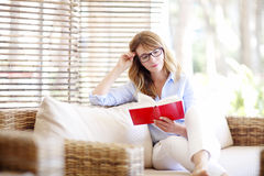 Beautiful woman relaxing at home Royalty Free Stock Photo