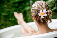 Beautiful woman taking a bath Stock Images