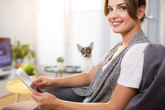 Beautiful woman relaxing at home using tablet Stock Photography