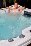 Beautiful woman relaxing in hot tub. Royalty Free Stock Photo