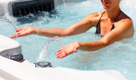 Beautiful woman relaxing in hot tub. Royalty Free Stock Images