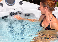Beautiful woman relaxing in hot tub. royalty free stock image