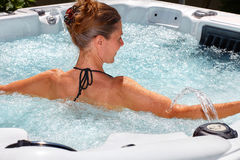 Beautiful woman relaxing in hot tub. stock images