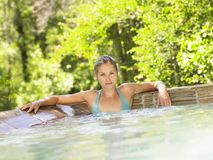 Beautiful Woman Relaxing In Jacuzzi Stock Images