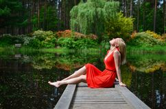 Beautiful woman relaxing by lake