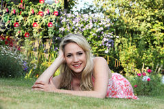 Beautiful woman relaxing on the lawn Royalty Free Stock Image